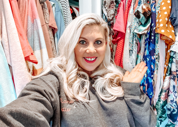 Louise Pentland stands in front of her wardobe of clothes